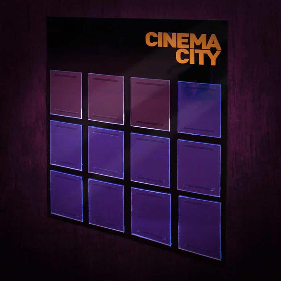 Négyszer hármas, falra szerelhető plexi szórólaptartó a Cinema City mozik számára.